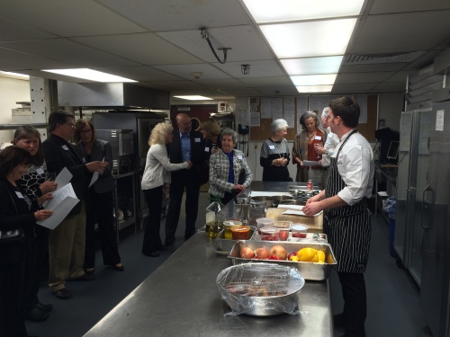 Madison Club's Chef Andrew Wilson gives a demonstration in preparing trout piperade for Rotarians and their guests.
