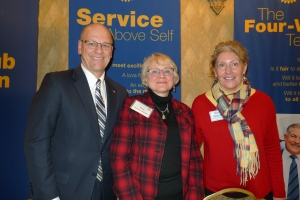 Pictured from left: Club President Tim Stadelman, Dean Kate VandenBosch and Rotarian Mary Kaminski